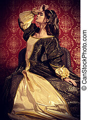 renaissance age - Beautiful young lady in the lush expensive...