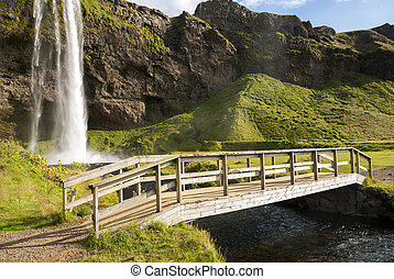 Seljalandsfoss waterfal - bridge over Seljalandsfoss...