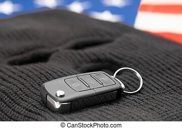 Car keys on black mask and USA flag - studio shot