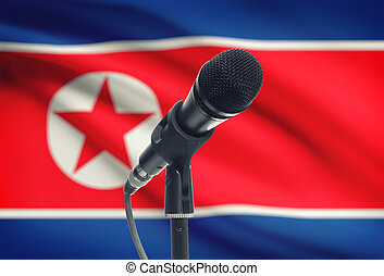 Microphone on stand with national flag on background - North...