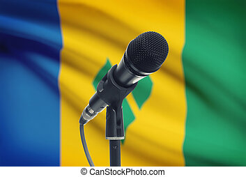 Microphone on stand with national flag on background - Saint...
