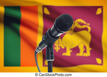 Microphone on stand with national flag on background - Sri...