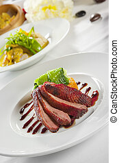 Oven crisp duck breast marinated in a Peking duck style...