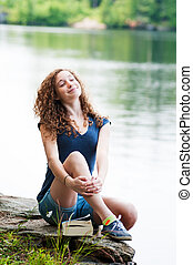 teen girl at a lake