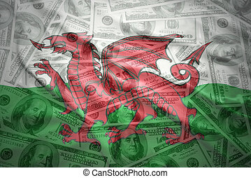 colorful waving welsh flag on a american dollar money...