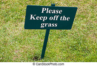 Please Keep of the Grass - A sign warning people to Keep off...