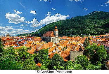 Brasov cityscape in Romania - Brasov cityscape with black...