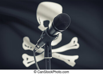 Microphone on stand with flag on background - Jolly Roger -...