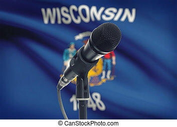 Microphone on stand with US state flag on background -...