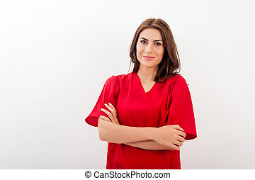 Portrait of happy young doctor woman standing isolated over...