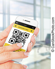 hand holding mobile phone with boarding pass