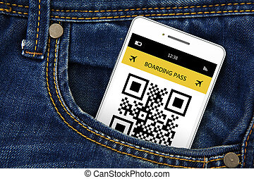 mobile phone with boarding pass in jeans pocket. focus on...