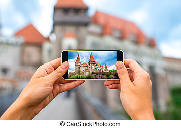 Photographing Corvin castle - Female hands photographing...