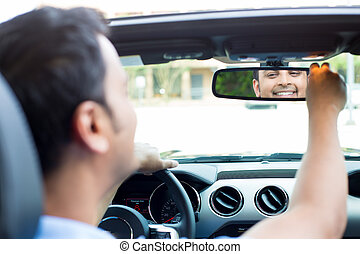 Happy at rearview mirror - Closeup portrait, happy young man...