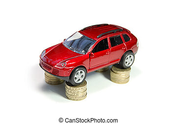 Car insurance - Toy car ontop of stacks of coins
