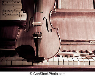 Violin and bow on Piano with sheet music - Violin with bow...