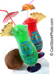 Two Tiki Tropical Drinks - Fun plastic tiki glasses filled...
