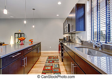 Retro kitchen with modern twist along with hardwood floor. -...