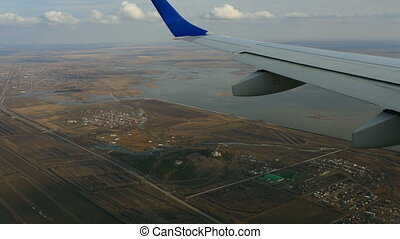 Aerial view from descending airplane, a suburb of Astana,...