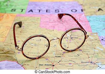 Glasses on a map of USA - Texas - Photo of glasses on a map...