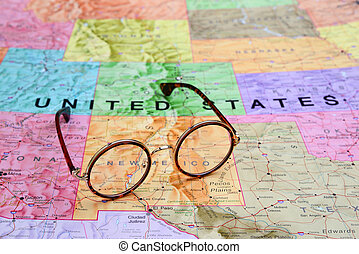 Glasses on a USA map - New Mexico - Photo of glasses on a...