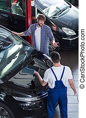 Motor vehicle service in auto repair shop