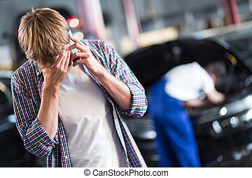 Waiting for car repair - Young despaired client waiting for...