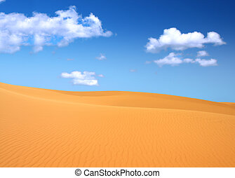 sand dunes and cumulus clouds over them, focus set in...