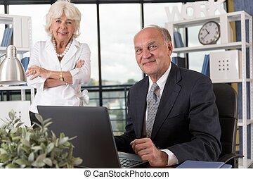 Elderly couple in bureau