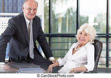 Elderly couple in office