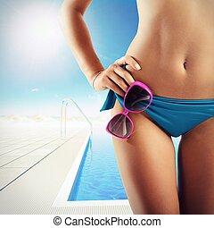 Bikini resort  pool - Girl in bikini in a resort pool