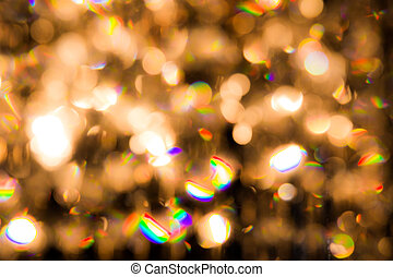 a crystal chandelier shines with golden light