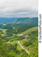 Winding Road in the Rocky Mountains - Winding road through...