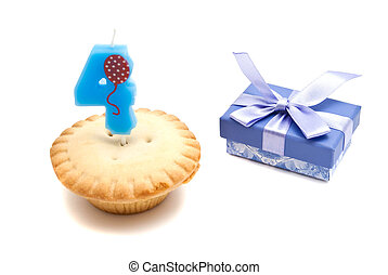 four years birthday candle with cupcake on white background