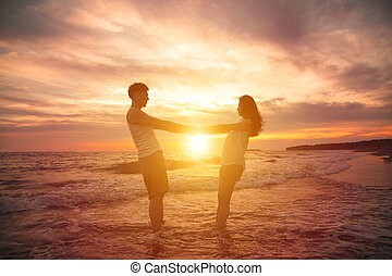young couple  at sunset on beach