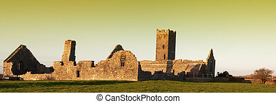 panoramic evening sunset of a decay abbey in ruins ireland -...