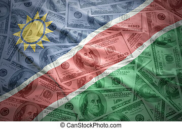 colorful waving namibian flag on a american dollar money...