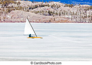 Ice-boat sailing frozen Lake Laberge Yukon Canada - Sailing...