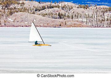 Ice-boat sailing frozen Lake Laberge Yukon Canada - Sailing...