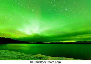 Aurora borealis sky frozen Lake Laberge Yukon - Green...
