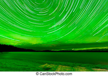 Startrails Aurora borealis frozen Lake Laberge -...
