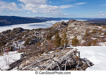 Frozen surface Lake Laberge spring Yukon Canada - Boreal...