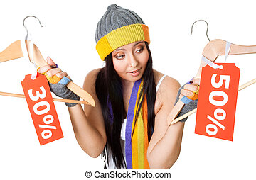 Woman thinking about sale - Woman think about sale offer...