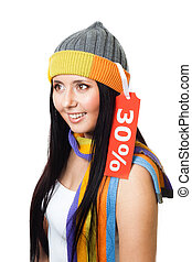 New year sale - Woman smile and wearing a cap with sale tag...