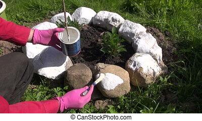 gardener paint in white stones