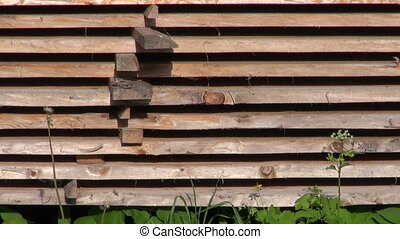 stack of old wooden boards planks in farm yard