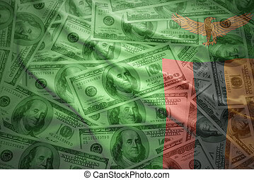 colorful waving zambian flag on a american dollar money...