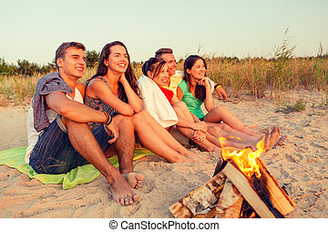 smiling friends in sunglasses on summer beach - friendship,...
