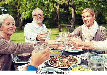 happy family having dinner in summer garden - family,...