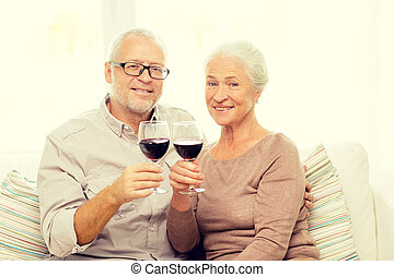 happy senior couple with glasses of red wine - family,...